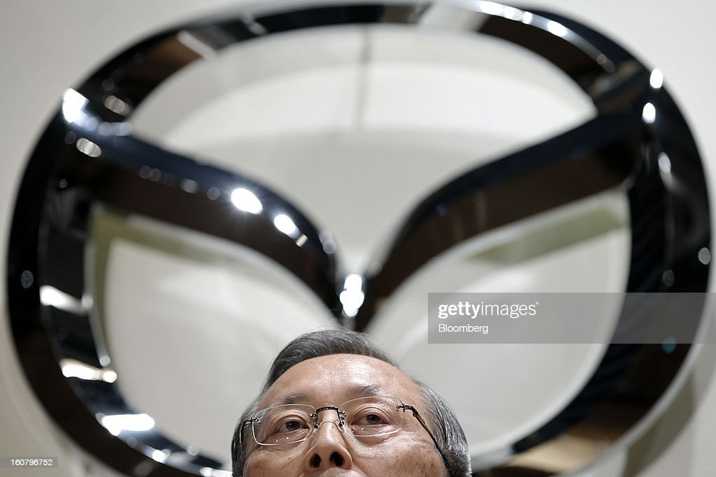 Takashi Yamanouchi, chief executive officer of Mazda Motor Corp., attends a news conference in Tokyo, Japan, on Wednesday, Feb. 6, 2013. Mazda, the best performer on the Nikkei 225 Stock Average in the past three months, more than doubled its full-year profit forecast on a weaker yen and demand for its fuel-efficient vehicles. Photographer: Kiyoshi Ota/Bloomberg via Getty Images