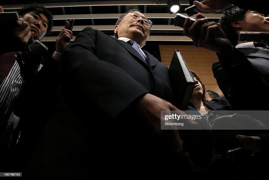 <a gi-track='captionPersonalityLinkClicked' href=/galleries/search?phrase=Takashi+Yamanouchi&family=editorial&specificpeople=5292471 ng-click='$event.stopPropagation()'>Takashi Yamanouchi</a>, chief executive officer of Mazda Motor Corp., center, leaves after speaking to members of the media following a news conference in Tokyo, Japan, on Wednesday, Feb. 6, 2013. Mazda, the best performer on the Nikkei 225 Stock Average in the past three months, more than doubled its full-year profit forecast on a weaker yen and demand for its fuel-efficient vehicles. Photographer: Kiyoshi Ota/Bloomberg via Getty Images