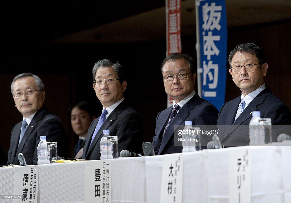 Takashi Yamanouchi chief executive officer of Mazda Motor Corp from left Toshiyuki Shiga chief operating officer of Nissan Motor Co Takanobu Ito...