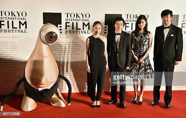 Takashi Yamazaki Japanese director of 'Parasyte' and actress Ai Hashimoto actor shota Sometani actress Rie Fukatsu and manga character Migi pose on...