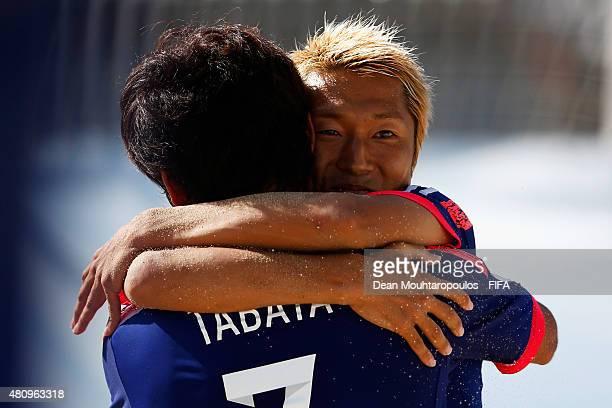Takasuke Goto of Japan celebrates scoring a goal with team mate Teruki Tabata during the FIFA Beach Soccer World Cup quarter final match between...