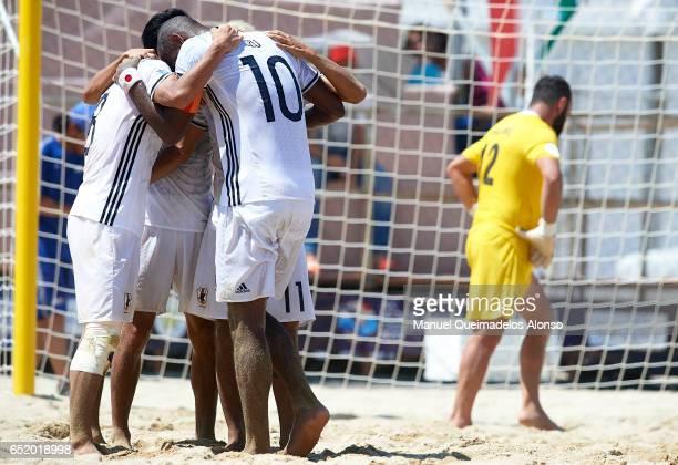 Takasuke Goto of Japan celebrates scoring his team's third goal with his teammates Takaaki Oba and Ozu Moreira during day seven of the AFC Beach...
