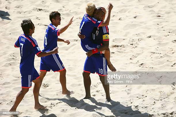 Takasuke Goto of Japan cew with team mates Naoya Matsuo Teruki Tabata and Ozu Moreira during the FIFA Beach Soccer World Cup Portugal 2015 Group A...