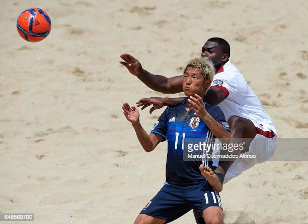 Takasuke Goto of Japan is tackled by Fawaz Daoud of Qatar during day three of the AFC Beach Soccer Championship 2017 match between Japan and Qatar at...