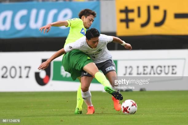 Takaya Inui of JEF United Chiba and Hayuma Tanaka of Matsumoto Yamaga compete for the ball during the JLeague J2 match between JEF United Chiba and...