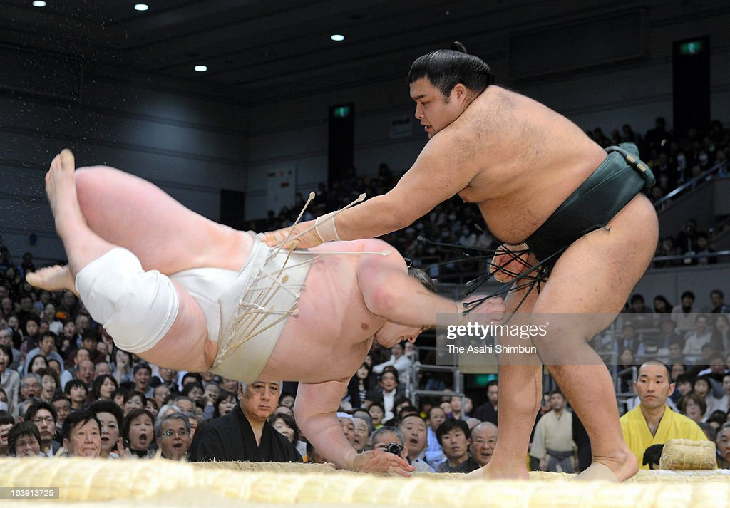 Takayasu (R) throws Baruto to win in day seven of the Grand Sumo Spring Tournament at Osaka Prefectural Gymnasium on March 16, 2013 in Osaka, Japan.