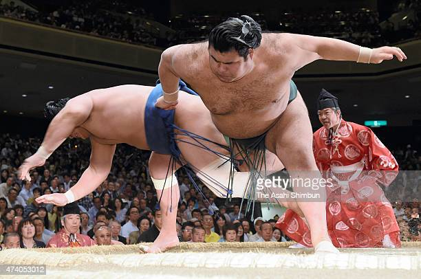 Takayasu throws Mongolian wrestler Kyokushuho to win during day ten of the Grand Sumo Summer Tournament at Ryogoku Kokugikan on May 19 2015 in Tokyo...