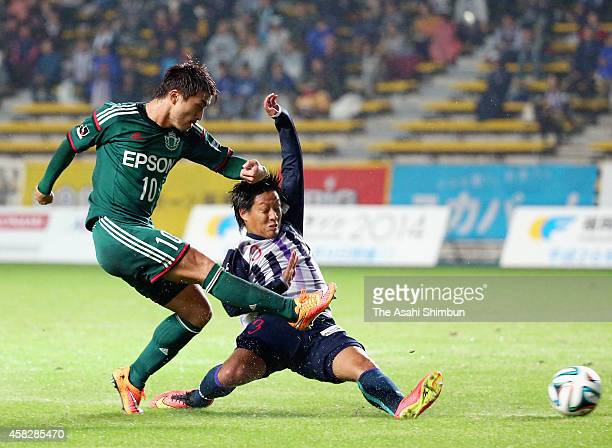 Takayuki Funayama of Matsumoto Yamaga scores his team's first goal during the JLeague second division match between Avispa Fukuoka and Matsumoto...
