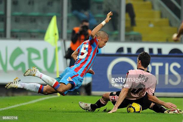 Takayuki Morimoto of Catania and Cesare Bovo of Plaermo compete for the ball during the Serie A match between US Citta di Palermo and Catania Calcio...