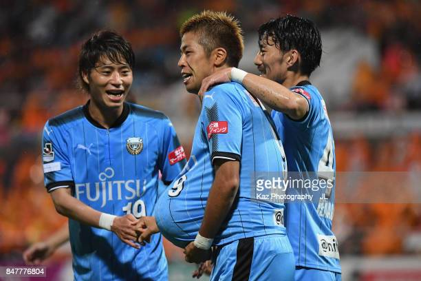Takayuki Morimoto of Kawasaki Frontale celebrates scoring his side's third goal with his team mates Kentaro Moriya and Akihiro Ienaga during the...