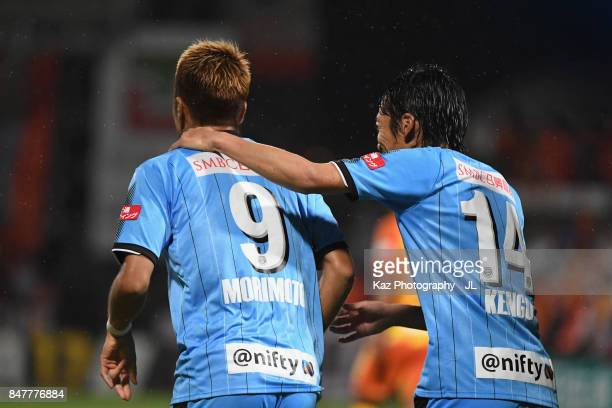 Takayuki Morimoto of Kawasaki Frontale celebrates scoring his side's third goal with his team mate Kengo Nakamura during the JLeague J1 match between...