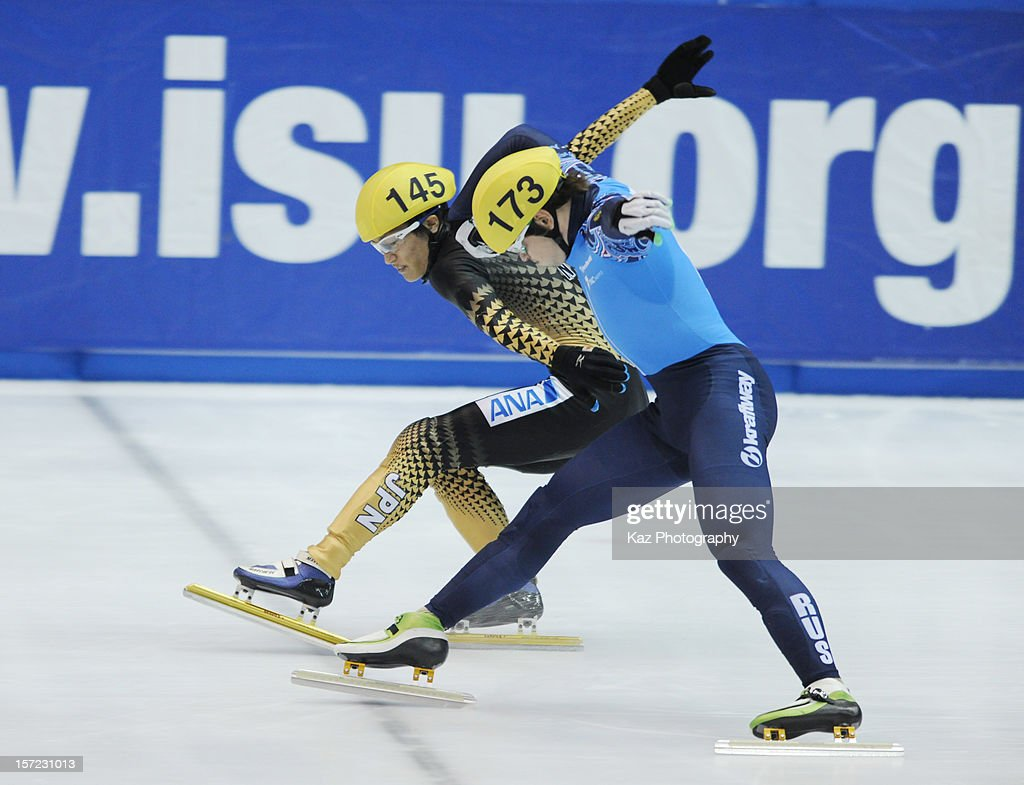 Takayuki Muratake of Japan tries to finish first in Race 10 of Men 1000m Preliminaries during day one of the ISU World Cup Short Track at Nippon Gaishi Arena on November 30, 2012 in Nagoya, Japan.