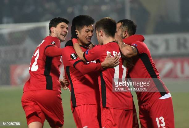 Takayuki Seto of Astra Giurgiu celebrates after he scored 22 during the UEFA Europa League round of 32 firstleg football match between FC Astra and...