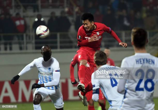 Takayuki Seto of Astra Giurgiu heads a ball during the UEFA Europa League round of 32 firstleg football match between FC Astra and RC Genk in Giurgiu...