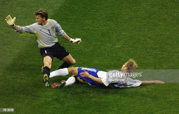 Takayuki Suzuki scores the first goal during the Group H match against Belgium of the World Cup Group Stage match played at the Saitama Stadium...