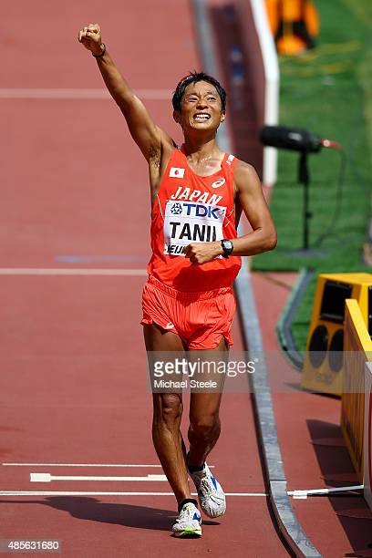 Takayuki Tanii of Japan celebrates after crossing the finish line to win bronze in the Men's 50km Race Walk final during day eight of the 15th IAAF...