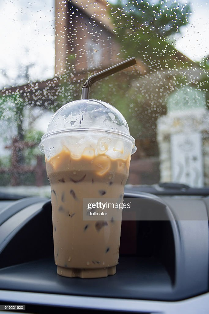 take away cup of iced coffee in a car : Bildbanksbilder