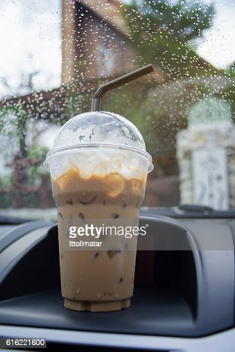 take away cup of iced coffee in a car : Stock-Foto