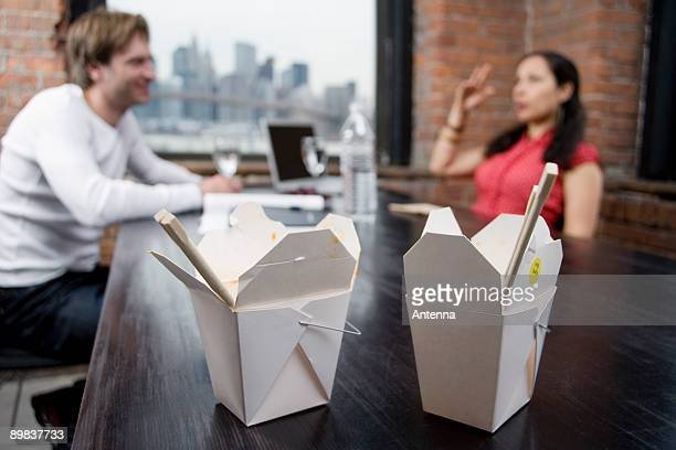 Take away food cartons on a dining table