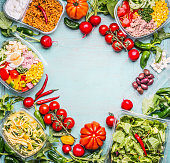 Healthy eating background with Variety of  vegetable and vegetables salad bowls. Fitness or diet  nutrition. Take away lunch ideas. Top view, frame