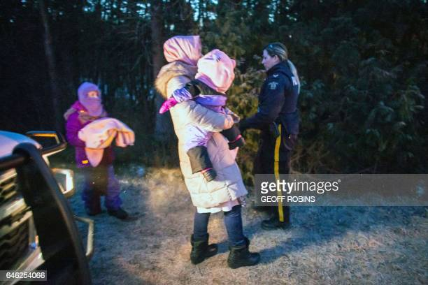 RCMP take members of an extended family of seven people from Turkey into custody after they illegally crossed the USCanada border just before dawn on...