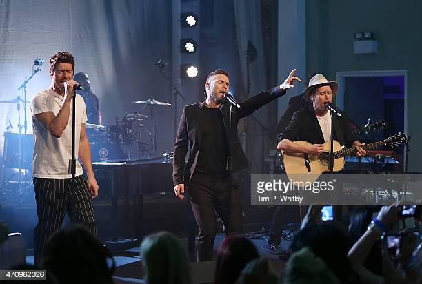 Take That Howard Donald Gary Barlow and Mark Owen perform during a secret gig for Magic FM at One Marylebone on April 24 2015 in London England