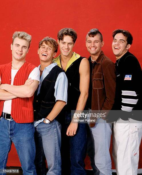 Take That studio group portrait London LR Gary Barlow Mark Owen Howard Donald Jason Orange Robbie Williams