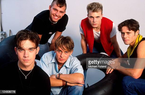 Take That studio group portrait London LR Robbie Williams Jason Orange Mark Owen Gary Barlow Howard Donald