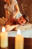 Shout of man enjoying back massage at spa
