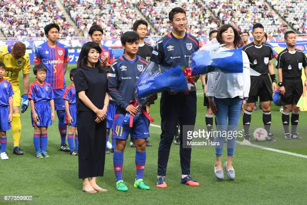 Takefusa Kubo and Go Hatano of FC Tokyo pose for photograph with their mothers the JLeague Levain Cup Group A match between FC Tokyo and Consadole...