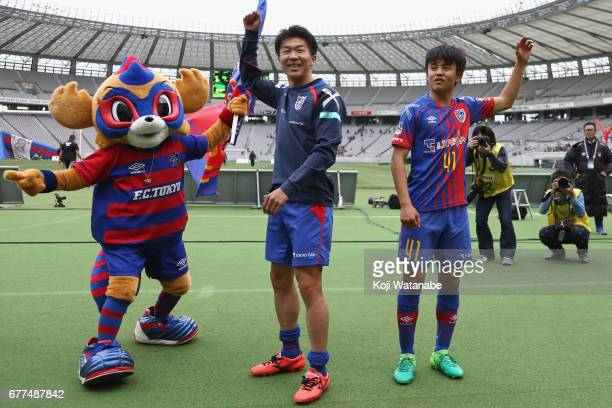Takefusa Kubo and Kensuke Nagai of FC Tokyo celebrate their team's 10 victory in the JLeague Levain Cup Group A match between FC Tokyo and Consadole...