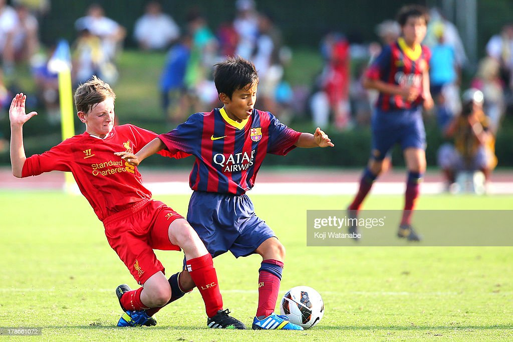 Takefusa Kubo of FC Barcelona in action during the U-12 Junior Soccer World Challenge 2013 final match between FC Barcelona and Liverpool FC at Ajinomoto Stadium on August 30, 2013 in Tokyo, Japan.