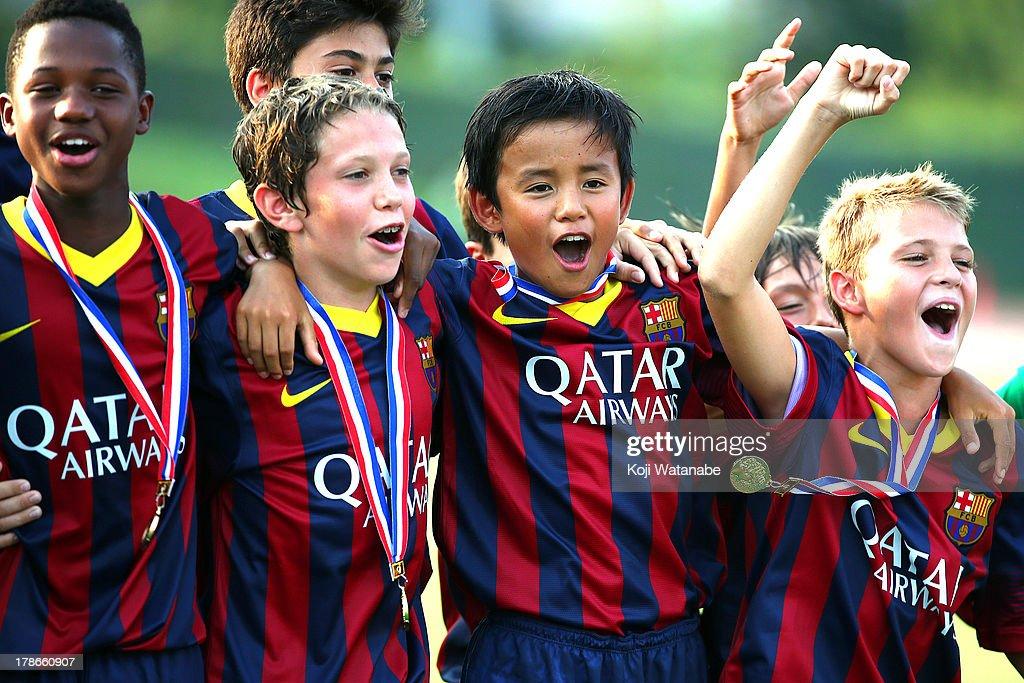 Takefusa Kubo (2R) of FC Barcelona Winner celebrate during the U-12 Junior Soccer World Challenge 2013 final match between FC Barcelona and Liverpool FC at Ajinomoto Stadium on August 30, 2013 in Tokyo, Japan.