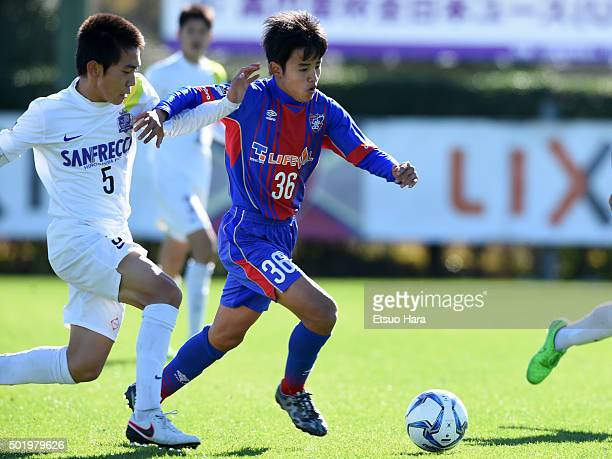 Takefusa Kubo of FC Tokyo U15 Musashi and Hirota Nishihara of Sanfrecce Horoshima Junior Youth in compete for the ball during the Prince Takamado...