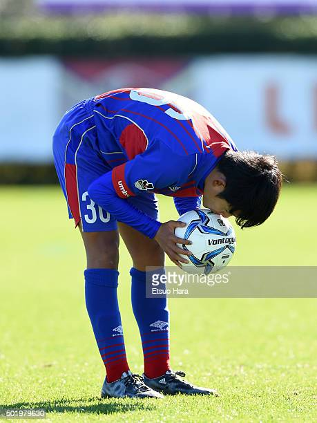Takefusa Kubo of FC Tokyo U15 Musashi kisses the ball before the free kick during the Prince Takamado Trophy All Japan Youth Football League...