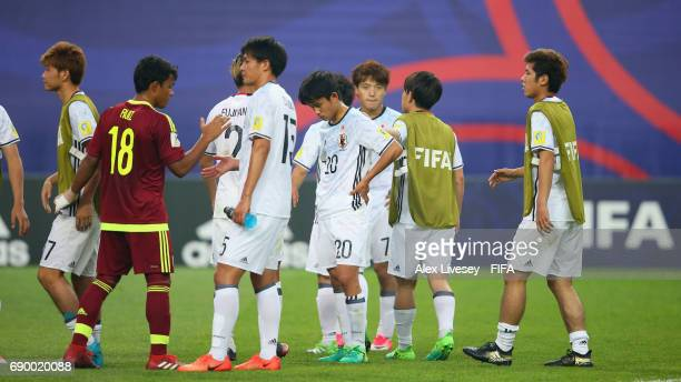 Takefusa Kubo of Japan and team mates look dejected after the FIFA U20 World Cup Korea Republic 2017 Round of 16 match between Venezuela and Japan at...