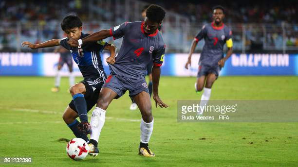 Takefusa Kubo of Japan battles for the ball with Kiam Wanesse of New Caledonia during the FIFA U17 World Cup India 2017 group E match between Japan...