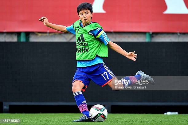 Takefusa Kubo of Japan kicks the ball during the friendly match between Thailand U16 and Japan U15 at Leo Stadium on July 23 2015 in Bangkok Thailand