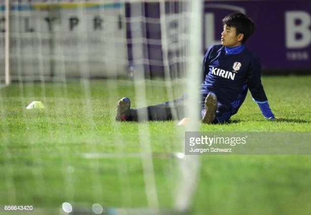 Takefusa Kubo of Japan sits on the pitch during a friendly soccer match between F91 Diddeleng and the Japan U20 team at Stade Jos Nosbaum on March 22...