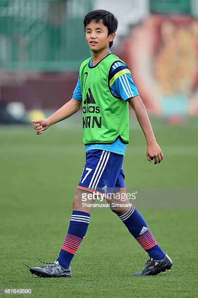 Takefusa Kubo of Japan smiles during the friendly match between Thailand U16 and Japan U15 at Leo Stadium on July 23 2015 in Bangkok Thailand