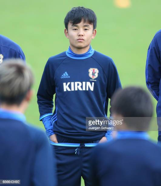 Takefusa Kubo of Japan stands beside teammates at a friendly soccer match between F91 Diddeleng and the Japan U20 team at Stade Jos Nosbaum on March...