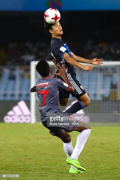 Takefusa Kubo R of Japan battles for the ball with Jekob Jeno of New Caledonia during the FIFA U17 World Cup India 2017 group E match between Japan...