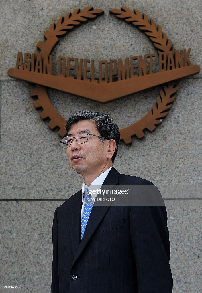 <a gi-track='captionPersonalityLinkClicked' href=/galleries/search?phrase=Takehiko+Nakao&family=editorial&specificpeople=10510436 ng-click='$event.stopPropagation()'>Takehiko Nakao</a>, Asian Development Bank (ADB) president, poses in front of the ADB logo after a press briefing at ADB headquarters in Manila on January 8, 2016. The ADB is cooperating closely with the China-backed Asian Infrastructure Investment Bank, and plans to co-finance projects beginning this year, the ADB president said January 8. AFP PHOTO / Jay DIRECTO / AFP / JAY