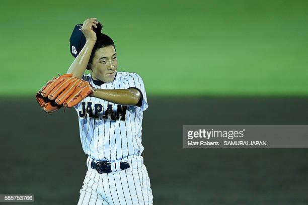 Takehiro Masuki of Japan smiles after the top half of the nineth inning in the super round game between Japan and Venezuela during The 3rd WBSC U15...
