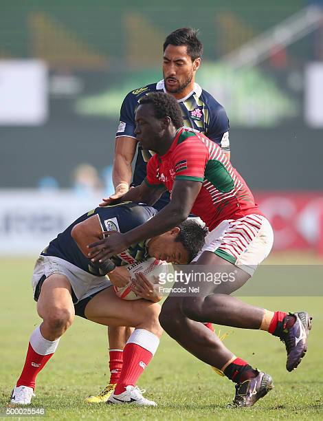 Takehisa Usuzuki of Japan is tackled by Billy Odhiambo of Kenya during the Emirates Dubai Rugby Sevens HSBC World Rugby Sevens Series at The Sevens...