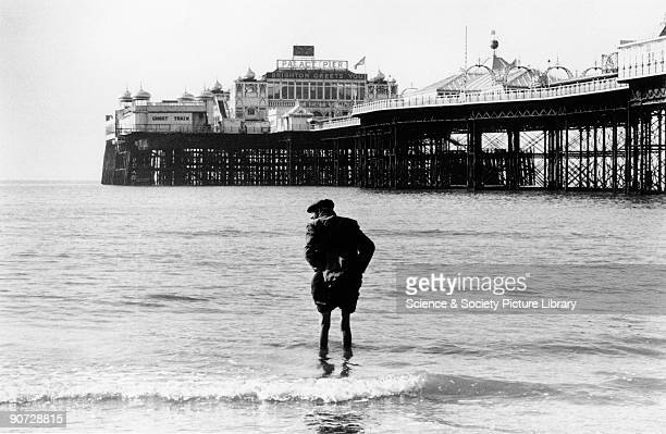 Taken near the Palace Pier at Brighton West Sussex Photographer Tony RayJones created most of his images of the British at work and leisure between...