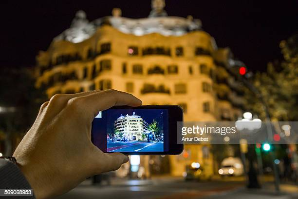 Taken pictures with smartphone of the Gaudi Pedrera in Barcelona city at night