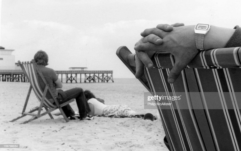 CONTENT] Taken sometime in the 80s on a scooter rally. Clasped hands on a deck chair.Hands only are visible.