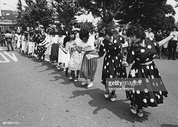 Takenokozoku dancers gather in Shibuya Tokyo Japan dressed in distinctive colourful baggy clothing 15th August 1980 Takenokozoku means 'bamboo shoot...