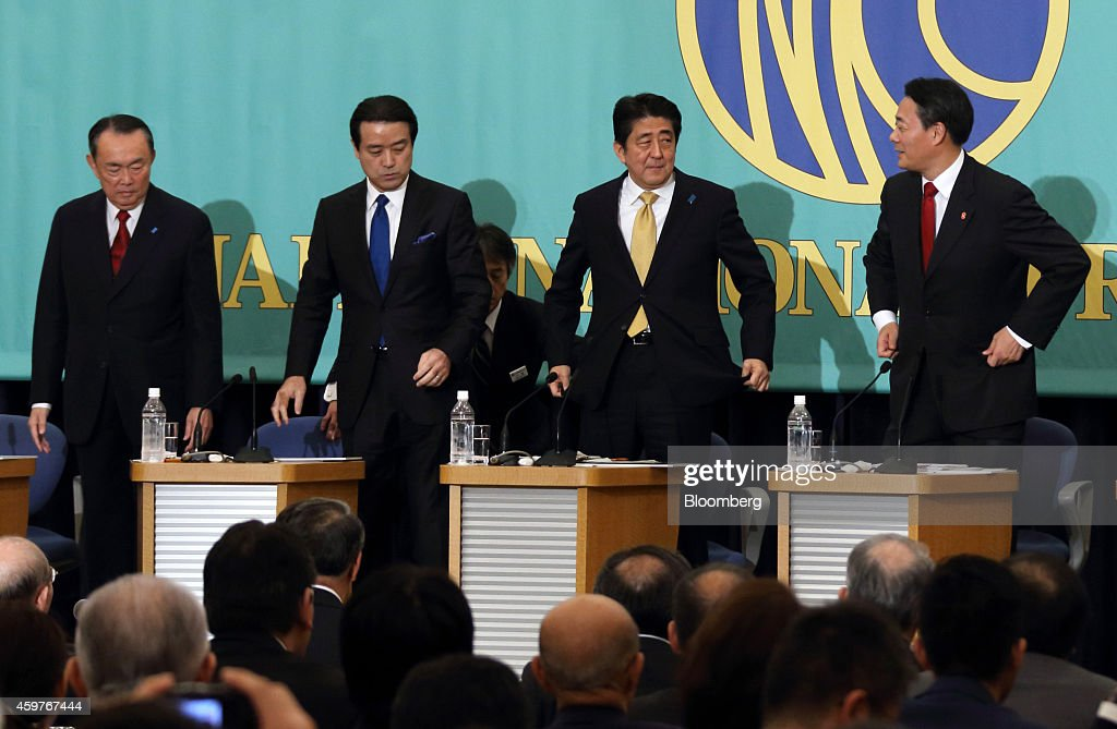 <a gi-track='captionPersonalityLinkClicked' href=/galleries/search?phrase=Takeo+Hiranuma&family=editorial&specificpeople=2078453 ng-click='$event.stopPropagation()'>Takeo Hiranuma</a>, chairperson of the Party for Future Generations, from left, <a gi-track='captionPersonalityLinkClicked' href=/galleries/search?phrase=Kenji+Eda&family=editorial&specificpeople=5666020 ng-click='$event.stopPropagation()'>Kenji Eda</a>, co-leader of the Japan Innovation Party, <a gi-track='captionPersonalityLinkClicked' href=/galleries/search?phrase=Shinzo+Abe&family=editorial&specificpeople=559017 ng-click='$event.stopPropagation()'>Shinzo Abe</a>, Japan's prime minister and president of the Liberal Democratic Party (LDP), and <a gi-track='captionPersonalityLinkClicked' href=/galleries/search?phrase=Banri+Kaieda&family=editorial&specificpeople=7193235 ng-click='$event.stopPropagation()'>Banri Kaieda</a>, president of the Democratic Party of Japan (DPJ) pose for a group photograph before their debate ahead of the Dec. 14 election at the Japan National Press Club in Tokyo, Japan, on Monday, Dec. 1, 2014. The economy will matter more to Japanese voters than security and nuclear policies when they cast their votes in the Dec. 14 election, media polls showed. Photographer: Tomohiro Ohsumi/Bloomberg via Getty Images